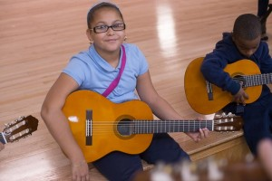 Students learning to play the guitar
